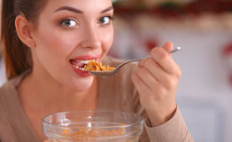 Happy young woman having healthy breakfast in Royalty Free Stock Photo
