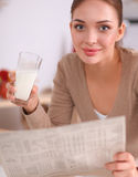 Happy young woman having healthy breakfast in Royalty Free Stock Image