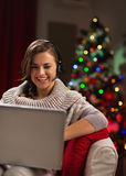 Happy young woman having video chat with family Stock Images
