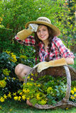 Happy young woman with hay hat Stock Images
