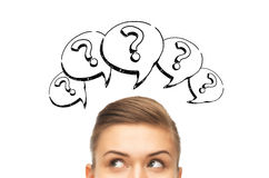 Happy young woman head with question marks royalty free stock photos