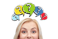 Happy young woman head with question marks Royalty Free Stock Image