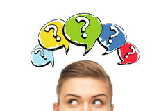 Happy young woman head with question marks Royalty Free Stock Photography