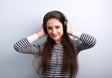 Happy young woman in headphones listening the music Royalty Free Stock Photo