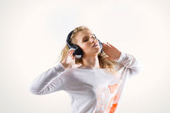Happy young woman with headphones listening to music Stock Photo