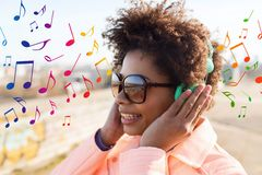 Happy young woman in headphones listening to music Stock Images