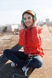 Happy young woman in headphones listening to music Royalty Free Stock Photography