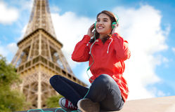 Happy young woman in headphones listening to music Royalty Free Stock Images