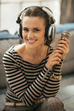 Happy young woman with headphones and microphone Royalty Free Stock Photos
