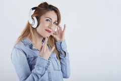 Happy young woman with headphones royalty free stock photography