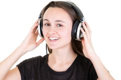 Happy young woman with headphones on white background royalty free stock photo