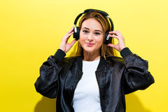 Happy young woman with headphones Royalty Free Stock Photos