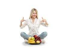 Happy young woman and healthy vegetarian food, fruit. Concept of stock image