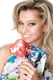 Happy young woman with a heart candy Royalty Free Stock Photography