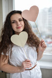 Happy young woman with heart love symbol.  stock image