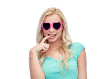 Happy young woman in heart shape sunglasses Stock Photography