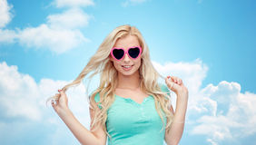 Happy young woman in heart shape sunglasses Royalty Free Stock Photography