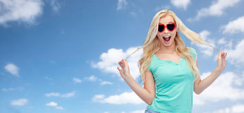 Happy young woman in heart shape sunglasses Royalty Free Stock Photos