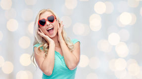 Happy young woman in heart shape sunglasses Royalty Free Stock Image