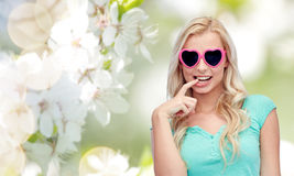 Happy young woman in heart shape sunglasses Royalty Free Stock Images