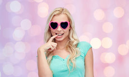 Happy young woman in heart shape sunglasses Stock Photo