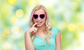 Happy young woman in heart shape sunglasses Stock Image