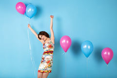 Happy young woman with helium air balloons. stock images