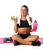 Happy young woman with her fitness equipment Stock Images
