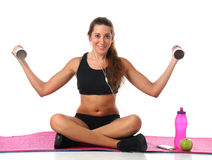 Happy young woman with her fitness equipment Stock Photography