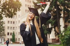 Happy young woman on her graduation day stock photography