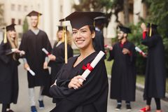 Happy young woman on her graduation day royalty free stock photography
