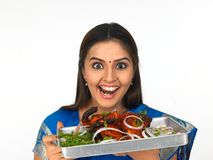 A happy young woman with her roasted chicken. And mouth watering Royalty Free Stock Image