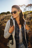 Happy young woman hiking on a sunny day Stock Photo