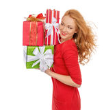 Happy young woman hold red Christmas wrapped gift present smilin Royalty Free Stock Photography