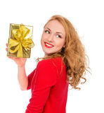 Happy young woman hold red Christmas wrapped gift present smilin Royalty Free Stock Photos