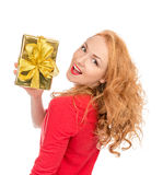 Happy young woman hold red Christmas wrapped gift present smilin Stock Photos