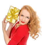 Happy young woman hold red Christmas wrapped gift present smilin Stock Image