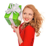 Happy young woman hold red Christmas wrapped gift present smilin Stock Photography
