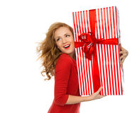 Happy young woman hold red Christmas wrapped gift present smilin Stock Photo