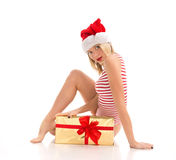 Happy young woman hold red Christmas wrapped gift present smilin Royalty Free Stock Images