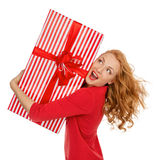 Happy young woman hold red Christmas wrapped gift present smilin Royalty Free Stock Image