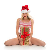 Happy young woman hold red Christmas wrapped gift present smilin Stock Images
