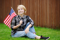 Happy young woman holding american flag Stock Images