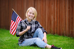 Happy young woman holding american flag Royalty Free Stock Images
