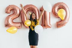 Happy young woman holding balloons Holiday party Royalty Free Stock Image