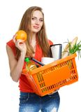 Happy young woman holding a basket full of healthy food on white Royalty Free Stock Photography