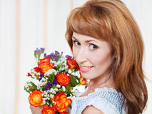 Happy young woman holding bid bouquet of flowers Royalty Free Stock Images
