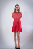 Happy young woman holding a big heart present valentine's day Royalty Free Stock Photo