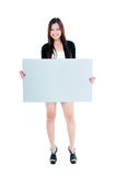 Happy Young Woman Holding Billboard. Portrait of a beautiful young woman holding blank billboard over white background Royalty Free Stock Image