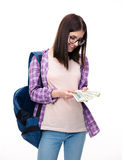 Happy young woman holding bills of dollar Stock Photos